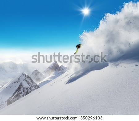 Man skier running downhill on sunny Alps slope #350296103
