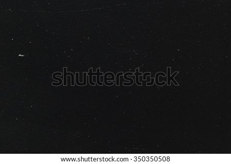 White dust and scratches on black background - layer for photo editor. Horizontal photo