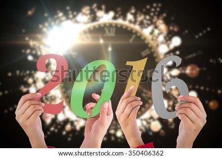 Hands showing 2016 against clock counting down to midnight #350406362