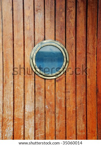circular window on a timber door of a boat #35060014