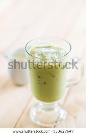 iced matcha latte on wood background #350629649