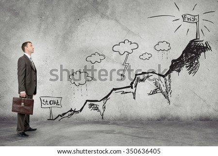 Thoughtful young businessman standing on dark chalkboard background. Concept for successful project
