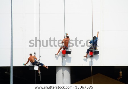 Climbers perform work for clearing walls of shopping center