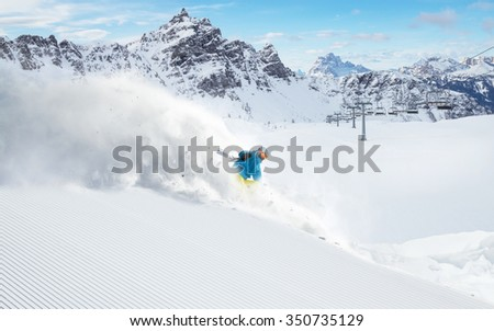 Skier skiing downhill in high mountains #350735129