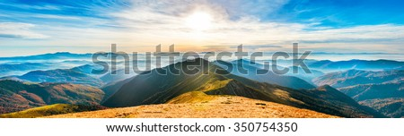 Mountain landscape at sunset. Panorama of beautiful view on hills #350754350