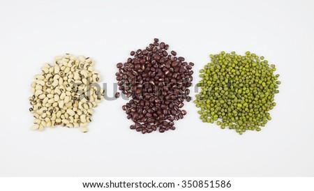 Black eye peas, mung bean and adzuki beans on white background #350851586