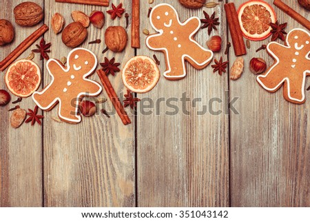 Gingerbreads with spices on the wooden table. Christmas aroma decor #351043142