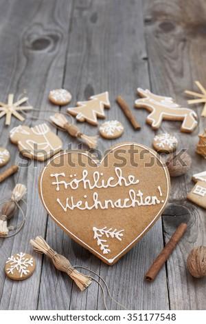 Heart shaped Christmas Gingerbread written in German #351177548