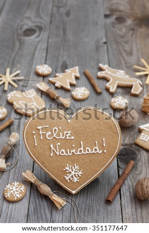 Heart shaped Christmas Gingerbread written in Spanish #351177647
