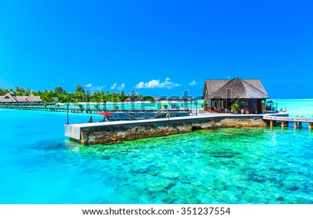 beach with water bungalows at Maldives #351237554