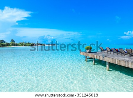 beach with water bungalows at Maldives #351245018