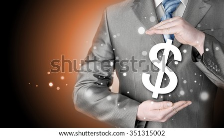 businessman protecting dollar symbol #351315002