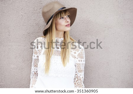 Bohemian styled young woman looking away Royalty-Free Stock Photo #351360905