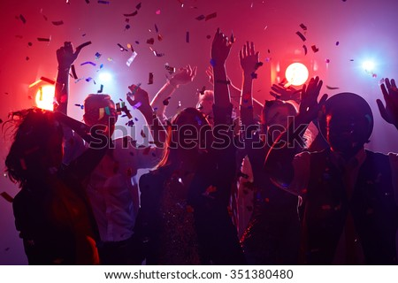 Young people dancing in night club Royalty-Free Stock Photo #351380480