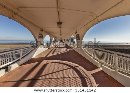 LIGNANO SABBIADORO, ITALY -DECEMBER 10, 2015: Covered pier and terrazza a mare in Lignano Sabbiadoro, Friuli, Venezia Giulia #351451142