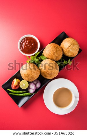 Kachori is a spicy snack from India also spelled as kachauri and kachodi. Served with tomato ketchup. Favourite Tea time snacks Selective focus #351463826