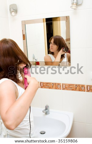 Woman in the mirror drying hair #35159806