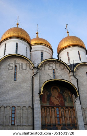 Dormition church. Moscow Kremlin. UNESCO World Heritage Site. Color photo. Blue evening sky background. #351601928