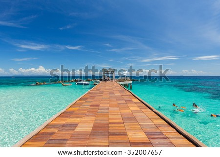 Summer, Travel, Vacation and Holiday concept - Wooden pier in Maiton Phuket Thailand Royalty-Free Stock Photo #352007657