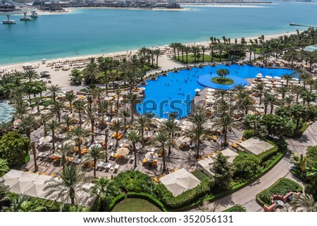 DUBAI, UAE - SEPTEMBER 7, 2015: A wonderful beach in 5 stars Hotel Atlantis (1,539 spacious guest rooms including 166 suites) on man-made island of Palm Jumeirah. United Arab Emirates.  #352056131