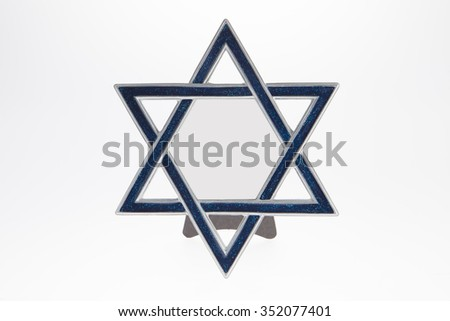 A Star of David picture frame against a white background