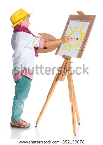 Little artist. Cute boy with watercolor painting, easel and palette, isolated on white background