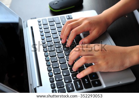 Close-up of typing female hands on keyboard #352293053