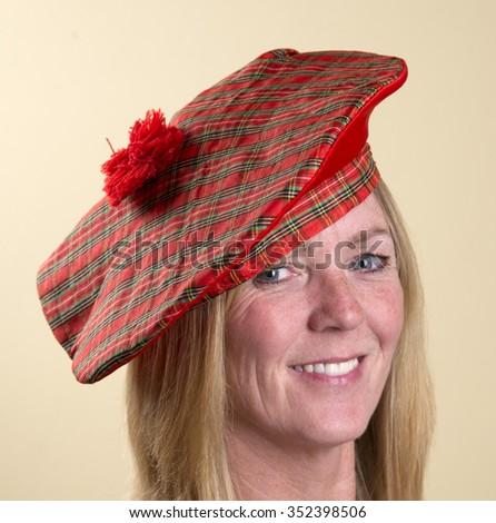 Portrait of a woman wearing a Tam o Shanter Scottish hat #352398506