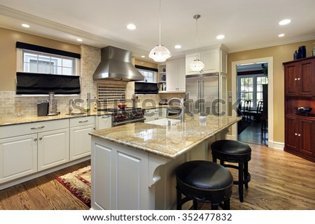 Kitchen with white cabinetry and center island #352477832