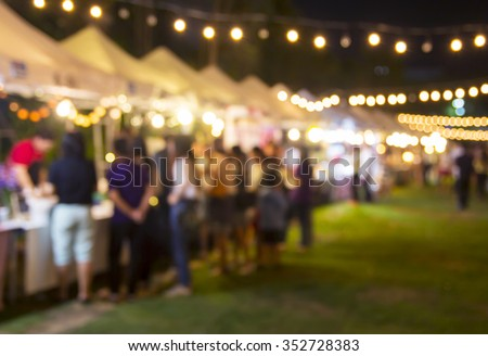 Abstract blurred background of people shopping at night festival Royalty-Free Stock Photo #352728383