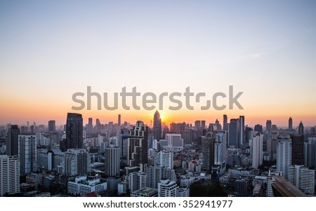 Cityscape and sunset at evening time Royalty-Free Stock Photo #352941977