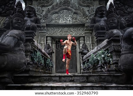 Muay Thai fighter preparing to fight Royalty-Free Stock Photo #352960790
