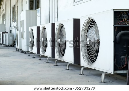 Air conditioner compressor installed in old building #352983299