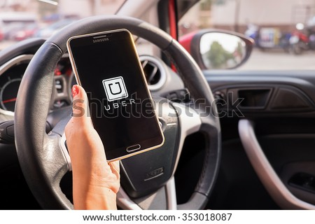 CHIANGMAI,THAILAND - DEC 16,2015 : A woman hand holding Uber app showing on Samsung note 3 in the car,Uber is smartphone app-based transportation network. #353018087