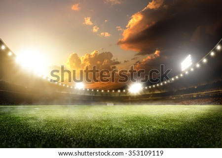 Empty sunset grand soccer arena in the lights Royalty-Free Stock Photo #353109119