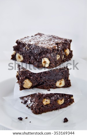 Decadent pieces of cocoa chocolate brownies dessert treat #353169344