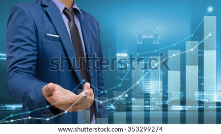 business man touch visual graph screen with cityscape background , business concept #353299274