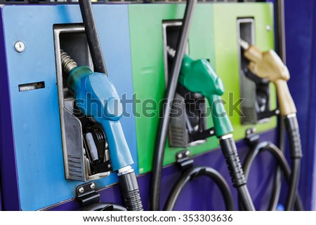Gas pump nozzles in a service station #353303636