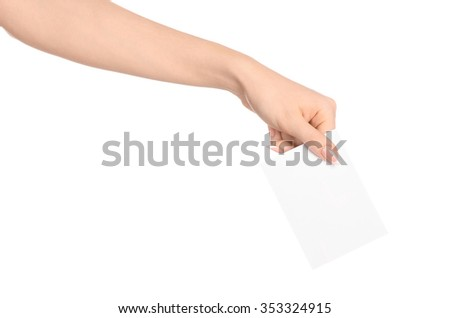 Branding and advertising theme: beautiful female hand holding a blank white paper card isolated on white background #353324915