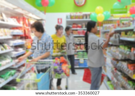 abstract blur of de focus background of people shopping in supermarket #353360027