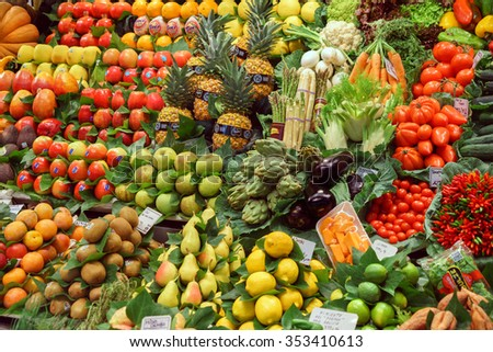 BARCELONA, SPAIN - September 29: Healthy Vegetables and Fruits in market on September 29, 2015 in Barcelona, Spain. Famous La Boqueria market / photography of the variety of fruits at the market. #353410613