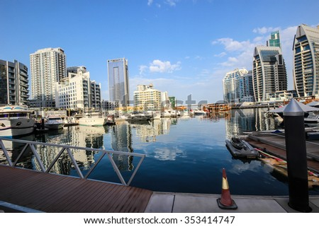 DUBAI, UAE - March 27, 2015: Modern buildings in Dubai Marina, UAE. In the city of artificial channel length of 3 kilometers, taken on March 27, 2015, in Dubai, United Arab Emirates #353414747