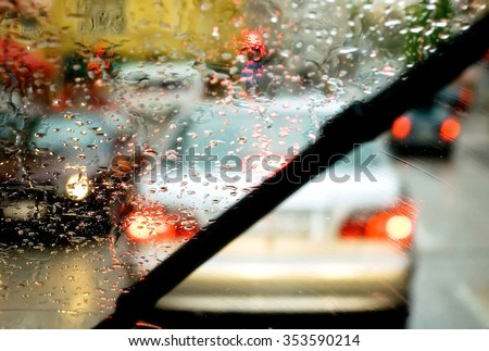 Windshield wipers from inside of car Royalty-Free Stock Photo #353590214