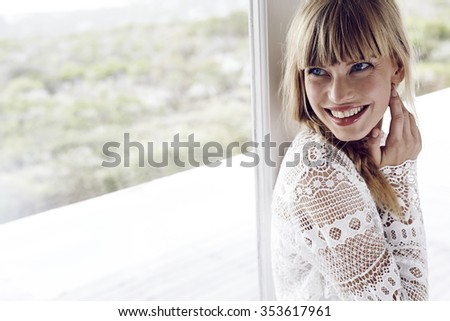 Beautiful young woman looking away with a smile Royalty-Free Stock Photo #353617961