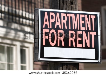 apartment for rent sign in front of an apartment building