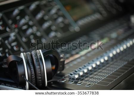 Headphones on sound mixer panel