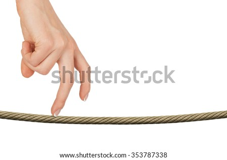 Womans fingers walking on rope on isolated white background