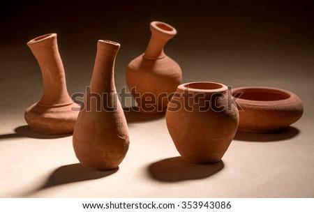 Artistic handmade ceramic clay brown terracotta pots tabletop, Mumbai, Maharashtra, India, Southeast Asia, #353943086