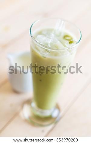 iced matcha latte on wood background #353970200