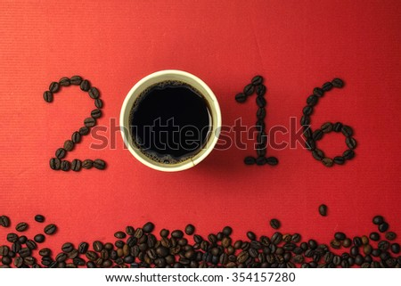 2016 coffee beans on paper texture in vintage style for new year concept